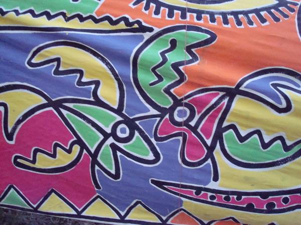 দীর্ঘ ব্যানারে একাংশে চিত্রিত এক জোড়া মাছ